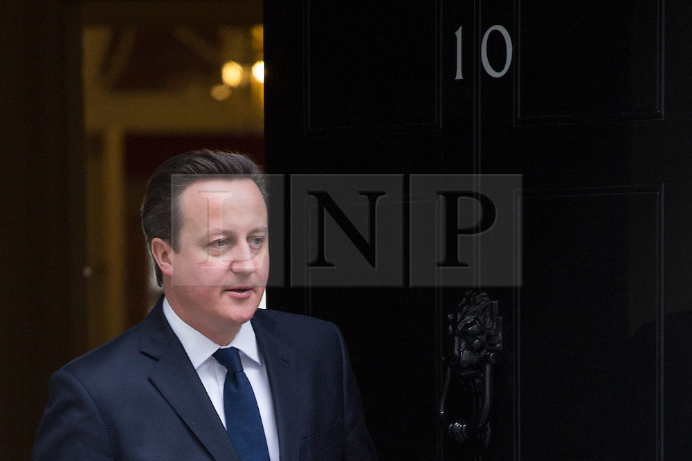 © licensed to London News Pictures. London, UK 21/01/2013. Prime minister David Cameron leaving No10 in Downing Street to welcome Prime Minister of Estonia, Andrus Anslip on Monday 21 January, 2013. Photo credit: Tolga Akmen/LNP