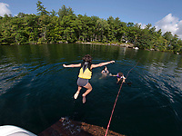 A refreshing jump into Lake Winnipesaukee.  (Karen Bobotas/for the Laconia Daily Sun)