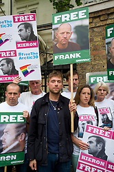 © London News Pictures. 05/10/2013.  London, UK. Musician Damon Albarn (centre) holding a placard showing the face of Frank Hewetson a Greenpeace activist at the demo.  Supporters of Greenpeace stage a demonstration outside the Russian Embassy in London to protest against the arrest of 30 Greenpeace activists, known as the 'Arctic 30' who charged with piracy by a Russian court, following a peaceful protest against Arctic oil drilling at an oil platform in the Pechora Sea. Photo credit Ben Cawthra/LNP