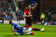James Tavernier of Rangers goes to ground to intercept the ball from Greg Taylor of Kilmarnock during the Ladbrokes Scottish Premiership match between Rangers and Kilmarnock at Ibrox, Glasgow, Scotland on 31 October 2018.