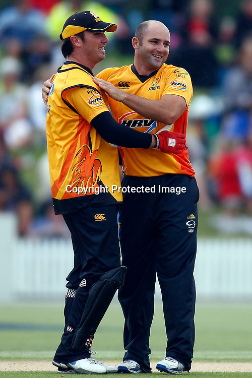 Brendan Taylor and Luke Woodcock celebrate the wicket of Daniel Vettori during the HRV Cup match between the Northern Knight v Wellington Firebirds. Men's domestic one day cricket. Blake Park, Mt Maunganui, New Zealand. 4 January 2012. Ella Brockelsby / photosport.co.nz