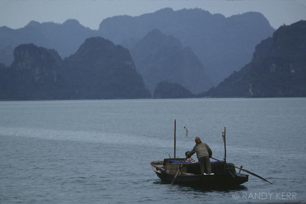 Solo rowboat on Halong Bay