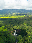 Aerial view of Wailua Falls, Kauai, Hawaii on a cloudy day.