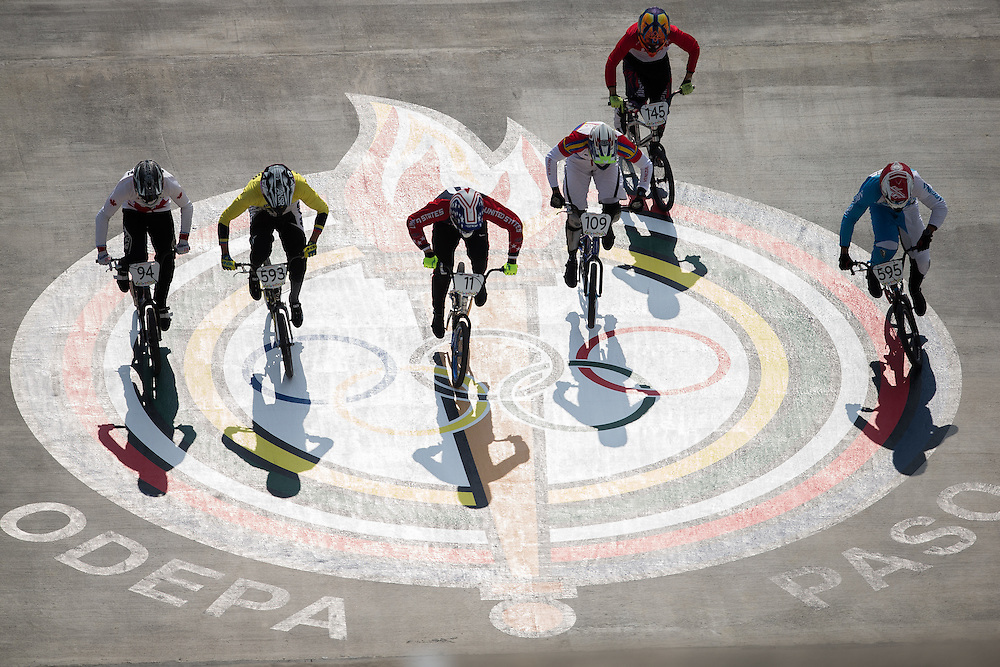 BMX riders cross the Pan American Games logo at the start of their heat at the 2015 Pan American Games in Toronto, Canada July 11,  2015.  AFP PHOTO/GEOFF ROBINS