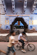 "Indian kids playing on the streets of Jodhpur which is often called the ""blue city"". Today Jodhpur is a popular tourist destination set near the barren landscape of the Thar desert.  Jodhpur is called the ""Blue City"" thanks to the vivid blue painted houses under the Mehrangarh Fort."