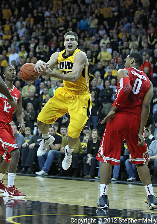 January 07, 2011: Iowa Hawkeyes guard/forward Eric May (25) loses the ball as he drives on Ohio State Buckeyes forward Jared Sullinger (0) during the the NCAA basketball game between the Ohio State Buckeyes and the Iowa Hawkeyes at Carver-Hawkeye Arena in Iowa City, Iowa on Saturday, January 7, 2012.