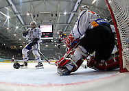 Kloten Flyers forward Victor Stancescu (hidden) scores the winning goal to the score of 3-2 against ZSC Lions goaltender Ari Sulander (R) and Alexey Krutov (L) during overtime in the ice hockey game five of the Swiss National League A Playoff Quarterfinal between Kloten Flyers and ZSC Lions held at the Kolping Arena in Kloten, Switzerland, Tuesday, March 8, 2011. (Photo by Patrick B. Kraemer / MAGICPBK)
