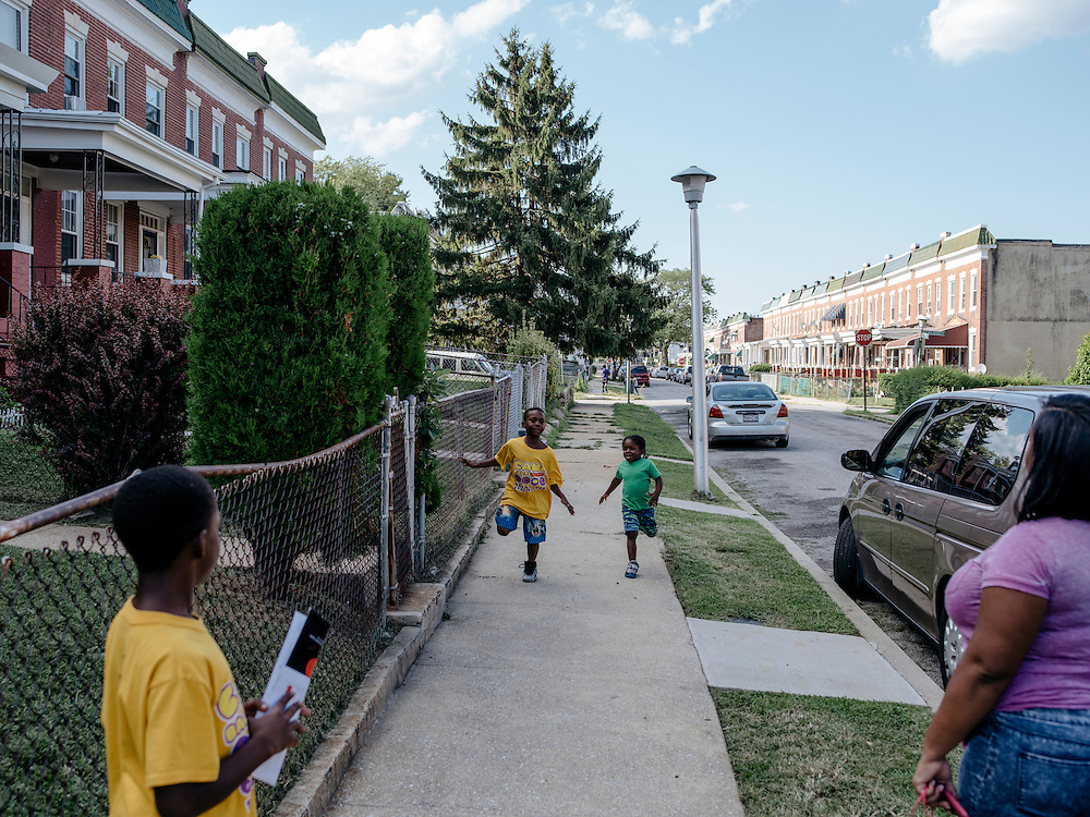 Amber Washington with her sons Isaiah Latham, 8, Elijah, 10, and Jeremiah, 4, live on the same block Odell lived on.