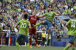 May 26, 2018 - Seattle, Washington, U.S - MLS Soccer 2018: RSL's BROOKS LENNON (12) and Seattle's LAMAR NEAGLE (27) go up for a header in hopes of gaining posession. Real Salt Lake visited the Seattle Sounders in a MLS match at Century Link Field in Seattle, WA. RSL won the match 1-0. (Credit Image: © Jeff Halstead via ZUMA Wire)