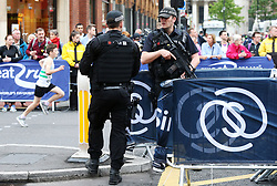 Armed police officers on patrol as thousands of defiant runners and spectators turn out for the Great Manchester Run, following the terror attack at the Manchester Arena in the city earlier this week.