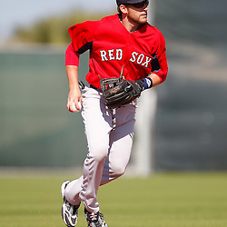 February 19, 2011; Fort Myers, FL, USA; Boston Red Sox second baseman Jed Lowrie (12) during spring training at the Player Development Complex.  Mandatory Credit: Derick E. Hingle