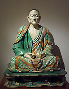 Statue of arhat Tâmrabhadra. Buddhist statue of a priest. Liao dynasty (947-1125 AD) Chinese. ceramic, terracotta, three-color decoration