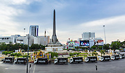 29 MAY 2014 - BANGKOK, THAILAND:  Police trucks around Victory Monument in Bangkok. After a series of protests around Victory Monument earlier in the week, the Thai army Thursday shut down vehicle access to the area, one of the main intersections in Bangkok, and kept people out of the area. Thousands of soldiers surrounded the Monument and effectively locked the area down. There were no protests at Victory Monument for the first time in the week since the coup deposed the elected civilian government.  PHOTO BY JACK KURTZ