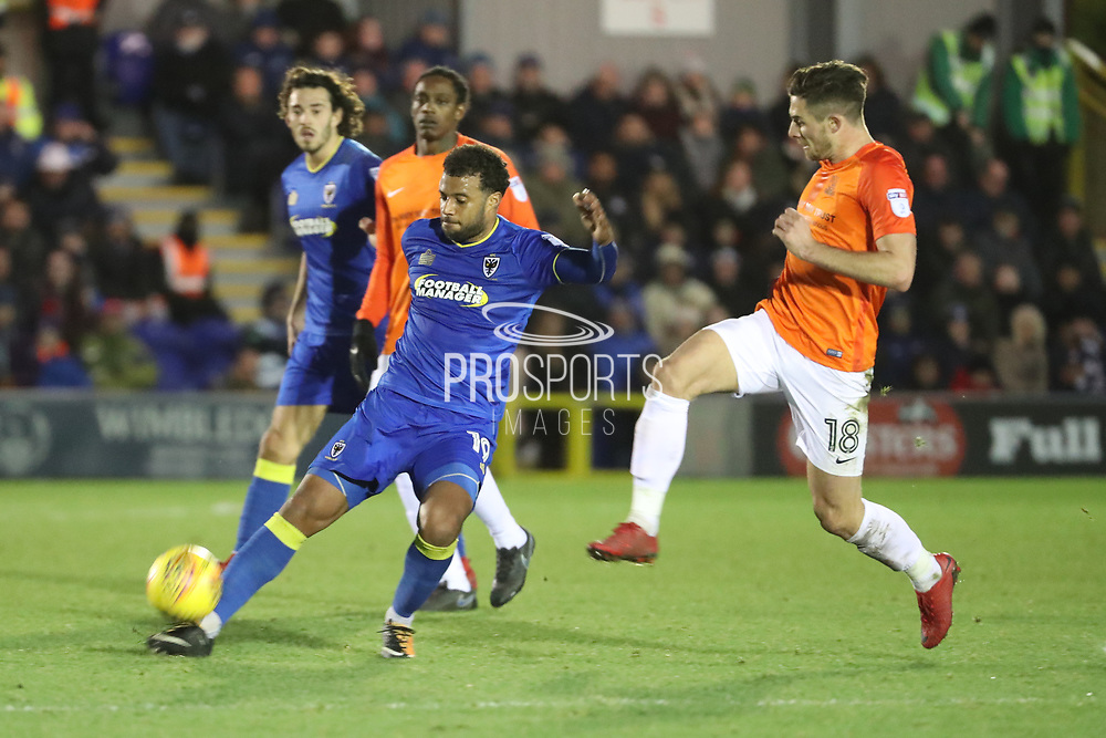 AFC Wimbledon midfielder Tom Soares (19) clearing from Southend United defender Ryan Leonard (18) during the EFL Sky Bet League 1 match between AFC Wimbledon and Southend United at the Cherry Red Records Stadium, Kingston, England on 1 January 2018. Photo by Matthew Redman.