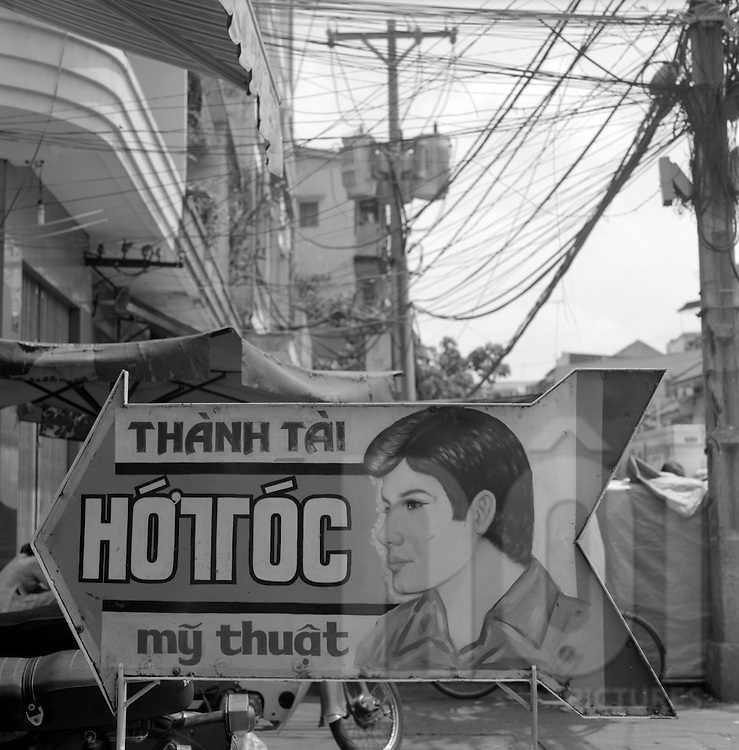 Sign promoting a Hairdresser shop  in Ho Chi Minh City, Vietnam.2005