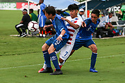 Team USA forward Osvaldo Reyes (7) fights for possession of the ball with Team Guatemala midfielders Gianluca Faillace (13) and  Diego Villatoro (5) during a CONCACAF boys under-15 championship soccer game, Monday, Aug. 5, 2019, in Bradenton, Fla. The USA defeated Guatemala  2-0 (Kim Hukari/Image of Sport)
