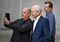 © Licensed to London News Pictures. 19/09/2019. London, UK. Veteran broadcaster JOHN HUMPHRYS is seen posing for a selfie with a passer by as he leaves BBC Broadcasting House in London following his final day on the BBC Radio 4 Today Programme. Photo credit: Ben Cawthra/LNP