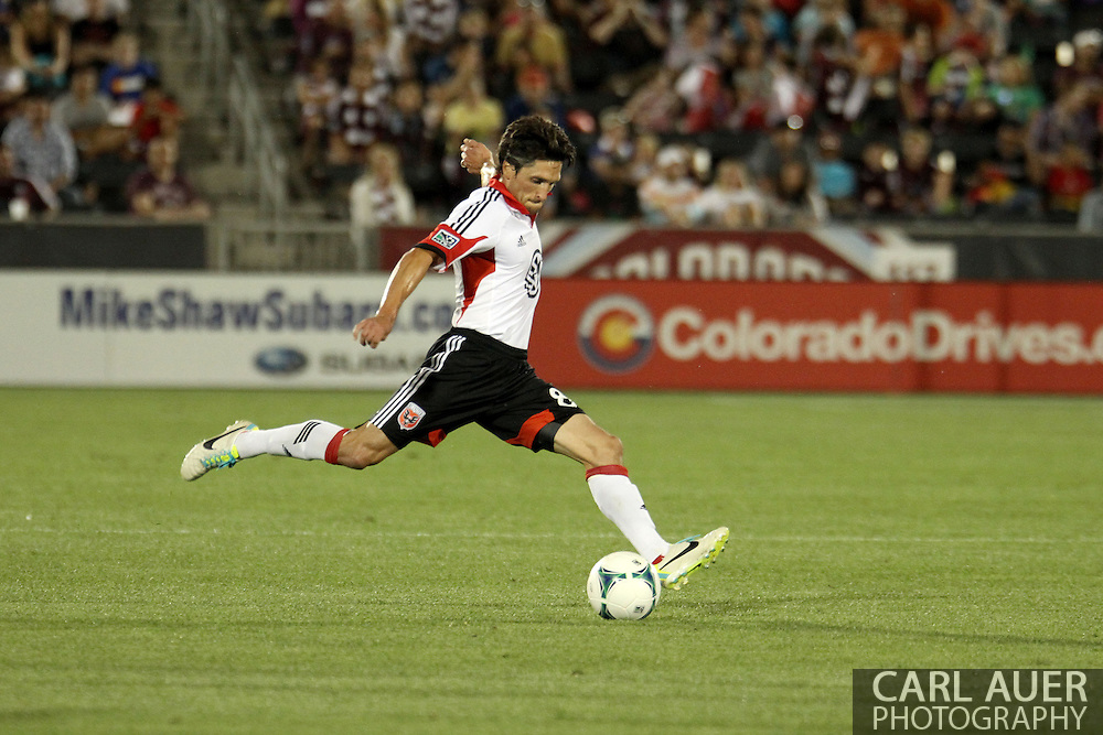 July 7th, 2013 - D.C. United midfielder John Thorrington (8) winds up for a long pass in the second half of action in the Major League Soccer match between D.C. United and the Colorado Rapids at Dick's Sporting Goods Park in Commerce City, CO