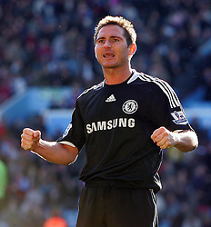 Chelsea midfielder Frank Lampard celebrates victory during the Barclays Premier League match between Aston Villa and Chelsea at Villa Park on February 21, 2009 in Birmingham, England.