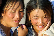 GOBI DESERT, MONGOLIA..08/30/2001.Tsagan Bulag, gers belonging to the family of 15-year-old Urna (r., with mother), winner of a gold medal in an English language school competition..(Photo by Heimo Aga).