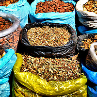 Spices in Colorful Sacks at Outdoor Market in Kampong Cham, Cambodia <br />