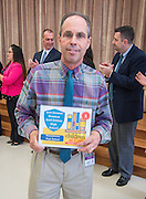 Robert Gasparello poses for a photograph during a Children at Risk awards presentation to area schools at Pilgrim Academy, June 6, 2016.