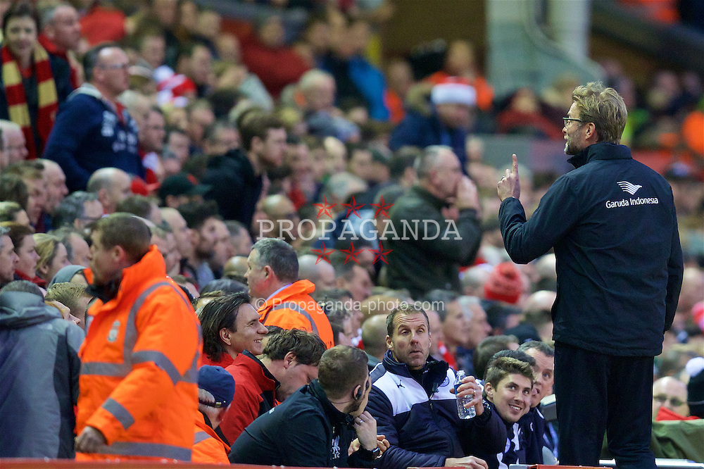 LIVERPOOL, ENGLAND - Boxing Day, Saturday, December 26, 2015: Liverpool's manager Jürgen Klopp shares a joke with a supporter during the Premier League match against Leicester City at Anfield. (Pic by David Rawcliffe/Propaganda)