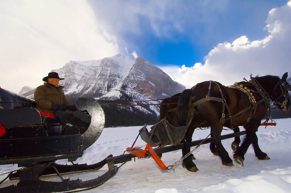 Sleigh ride on the edge of Lake Louise, Banff National Park, Alberta, Canada