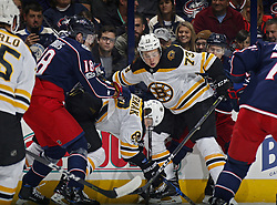 October 30, 2017 - Columbus, OH, USA - Columbus Blue Jackets center Pierre-Luc Dubois (18) checks Boston Bruins right wing David Pastrnak (88) during the 1st period of their NHL game at Nationwide Arena in Columbus, Ohio on Oct. 30, 2017. (Credit Image: © Kyle Robertson/TNS via ZUMA Wire)
