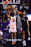 Jan 30, 2017; Phoenix, AZ, USA; Memphis Grizzlies guard Andrew Harrison (5) attempts to block Phoenix Suns guard Brandon Knight (11) in the first half of the NBA game at Talking Stick Resort Arena. Mandatory Credit: Jennifer Stewart-USA TODAY Sports