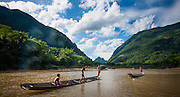 Boys on boats on Nan Ou river at Muang Ngoi (Laos)