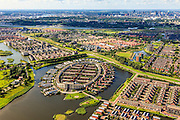 Nederland, Zuid-Holland, Barendrecht, 15-07-2012; VINEX wijk Carnisselande met in de Gaatkens Plas de wijk Koedood, wonen an het water in o.a. huizen in de vorm van vuurtorens..New Vinex housing estate Carnisselande in Barendrecht (near Rotterdam) . Lighthouse shaped homes. luchtfoto (toeslag), aerial photo (additional fee required).foto/photo Siebe Swart