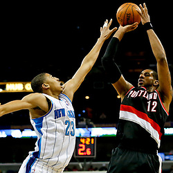 Feb 13, 2013; New Orleans, LA, USA; Portland Trail Blazers power forward LaMarcus Aldridge (12) shoots over New Orleans Hornets power forward Anthony Davis (23) during the second half of a game at the New Orleans Arena. The Hornets defeated the Trail Blazer 99-63. Mandatory Credit: Derick E. Hingle-USA TODAY Sports