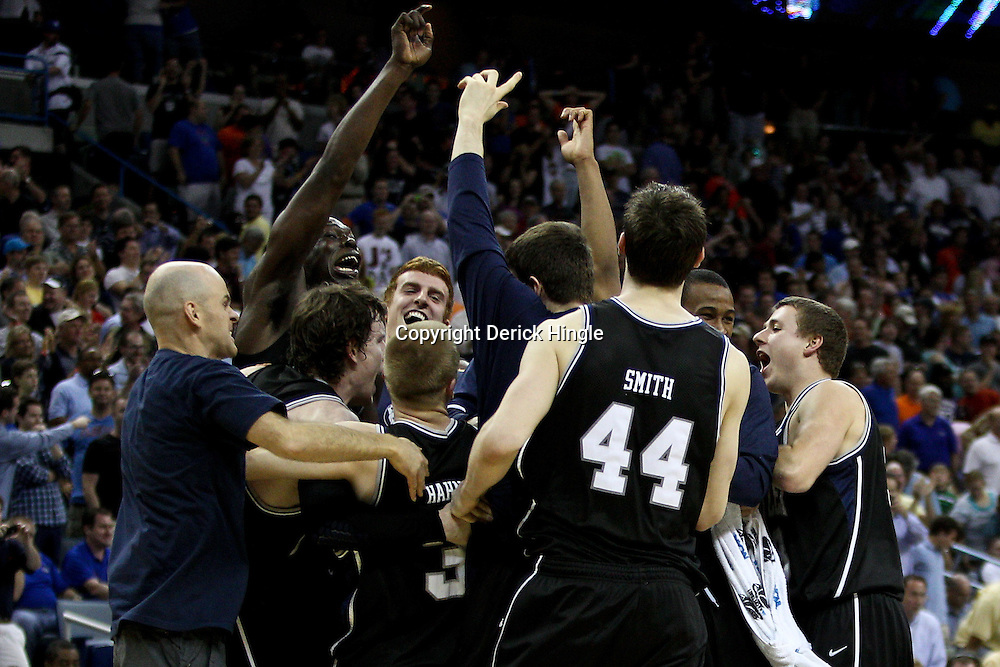 Mar 26, 2011; New Orleans, LA; Butler Bulldogs celebrate on the court following a win over the Florida Gators in the semifinals of the southeast regional of the 2011 NCAA men's basketball tournament at New Orleans Arena. Butler defeated Florida 74-71.  Mandatory Credit: Derick E. Hingle