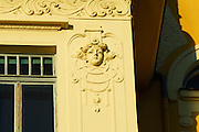 Detail of building facade, with female face in bas relief. Opatija, Croatia