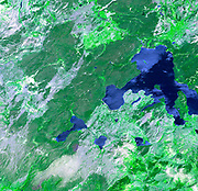 Thirteen years after devastating forest fires burned over 1.6 million acres in Yellowstone National Park, the scars are still evident. July 2, 2001. Satellite image.
