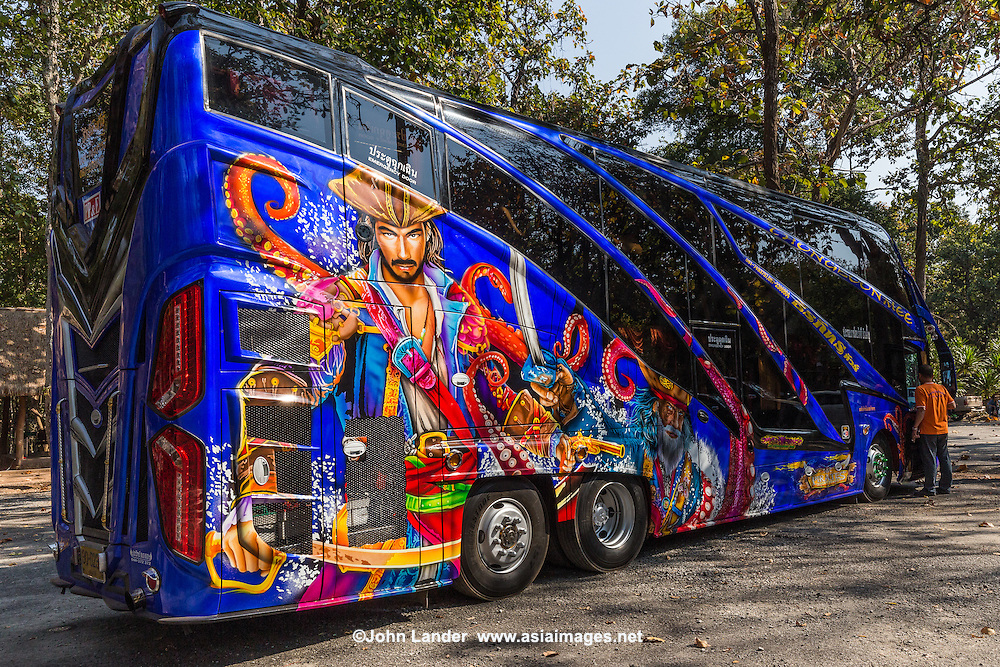 Thai tour bus and coaches paint lavish decorative graphics on their tourist buses, in addition to, shiny reflectors, floodlights and high volume speakers that turn some buses into colorful, mobile karaoke bars and discotheques.  Factories turn out these tourist coaches in response to the demand for bling.  Although the Thai tourist industry has suffered setbacks because of political protests for the last few years, demand for brightly painted buses has grown so much so that it rare to find one with a with a plainly painted finish.  Much more common these days are fantasy designs and characters from around the world, with detailed artwork from Disney, Marvel Comics and movies such as Jack Sparrow Pirates of the Caribbean - always popular in Thailand