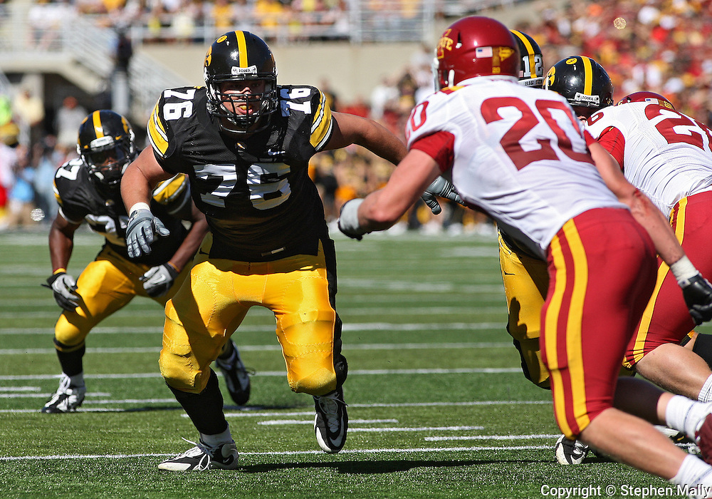 September 11 2010: Iowa Hawkeyes offensive linesman Nolan MacMillan (76) eyes Iowa State Cyclones linebacker Jake Knott (20) during the first half of the NCAA football game between the Iowa State Cyclones and the Iowa Hawkeyes at Kinnick Stadium in Iowa City, Iowa on Saturday September 11, 2010. Iowa defeated Iowa State 35-7.