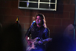 11 July 2012:  Kirk Ellis of Brushfire Band perform a concert on the concourse of the Corn Crib Stadium at Heartland Community College in Normal IL