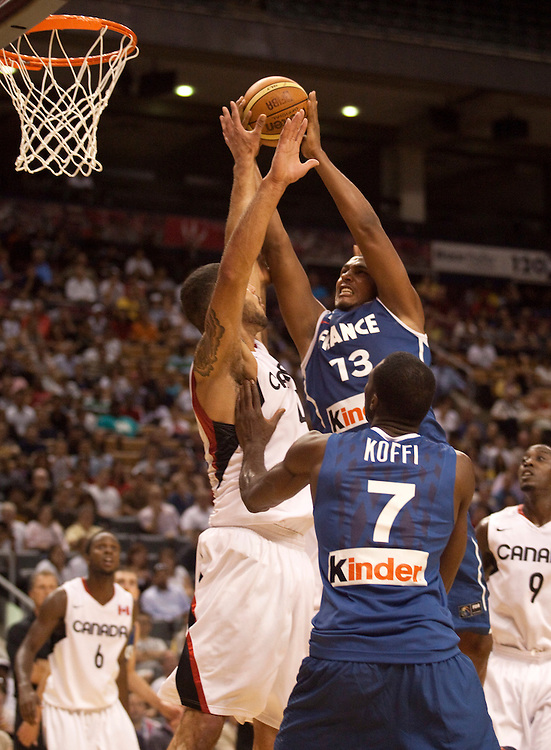 GJR505.jpg -20100812- Toronto, Ontario,Canada<br /> Canada's Robert Sacre, left tries to block a shot by France's Boris Diaw, right during a game in the 2010 Jack Donohue International Classic tournament in Toronto, Canada, August 12, 2010. Canada defeated France 69-58.<br /> AFP PHOTO/Geoff Robins