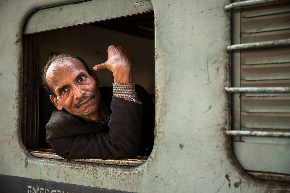 Man by the train window. Varanasi, India