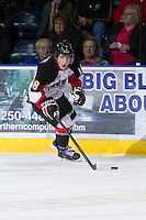KELOWNA, CANADA - DECEMBER 8: Jake Mykitiuk #18 of the Prince George Cougars skates with the puck at the Kelowna Rockets on December 8, 2012 at Prospera Place in Kelowna, British Columbia, Canada (Photo by Marissa Baecker/Shoot the Breeze) *** Local Caption ***