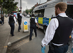 FILE IMAGE © Licensed to London News Pictures. 25/05/2018. London, UK. Police return to their van after they spot a man they want to question during a gang patrol in Islington. Photo credit: Peter Macdiarmid