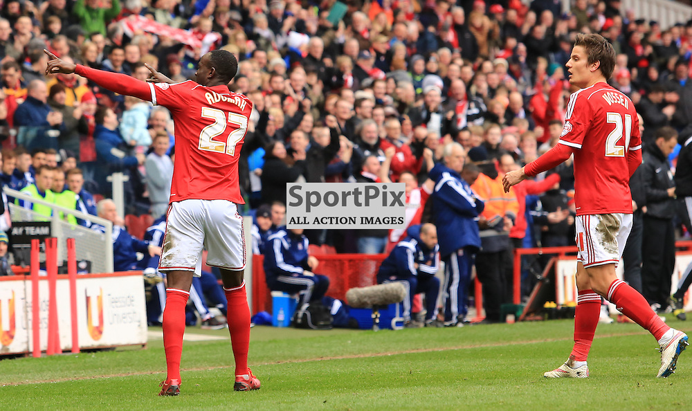 Middlesbrough midfielder Albert Adomah (27) celebrates with a dance in front of the home fans after scoring a stunning second goal during the Middlesbrough FC v Ipswich Town FC Sky Bet Championship 14th March 2015 ©Edward Linton | SportPix.org.uk