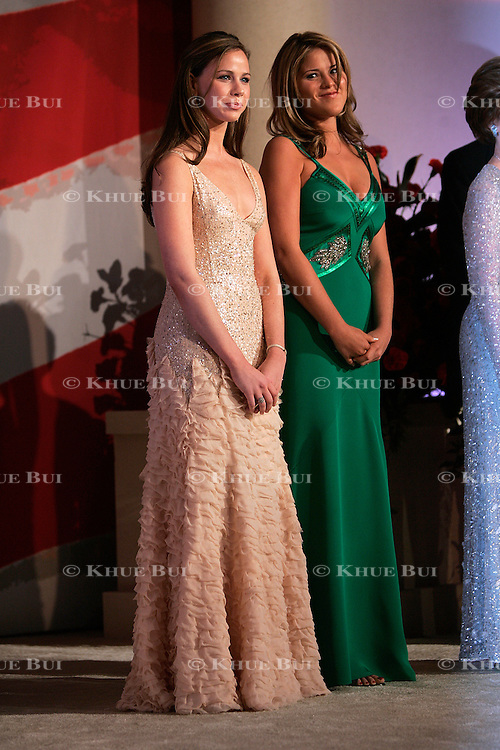 First daughters Barbara, left, and Jenna Bush look on as Pres. Bush and first lady Laura Bush attend Inaugural Balls Thursday, January 20, 2005, in Washington, DC...Photo by Khue Bui