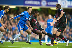 LONDON, ENGLAND - Saturday, December 12, 2009: Everton's Louis Saha and Chelsea's Ricardo Carvalho during the Premiership match at Stamford Bridge. (Photo by David Rawcliffe/Propaganda)