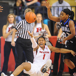 Rutgers Scarlet Knights guard Khadijah Rushdan (1) falls and loses control of the ball during first half NCAA Women's Basketball action between the Rutgers Scarlet Knights and Seton Hall Pirates at the Louis Brown Athletic Center. Rutgers leads Seton Hall 28-19 at halftime.