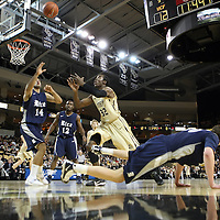 Arsalan Kazemi (14) of Iran, and Central Florida guard/forward Isaiah Sykes (32) reach for a rebound as Lucas Kuipers falls during a Conference USA NCAA basketball game between the Rice Owls and the Central Florida Knights at the UCF Arena on January 22, 2011 in Orlando, Florida. Rice won the game 57-50 and extended the Knights losing streak to 4 games.  (AP Photo/Alex Menendez)