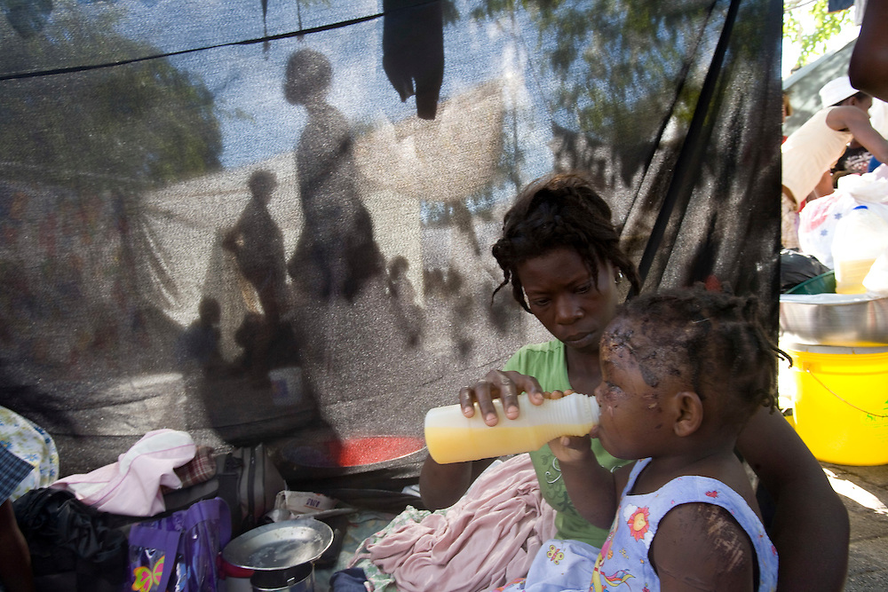Venette Vincent lost her mom in the devastating earthquake that rocked Haiti. Now, she is with her father and some members of the family in the street of Port- Au-Prince on Saturday January 16, 2010.