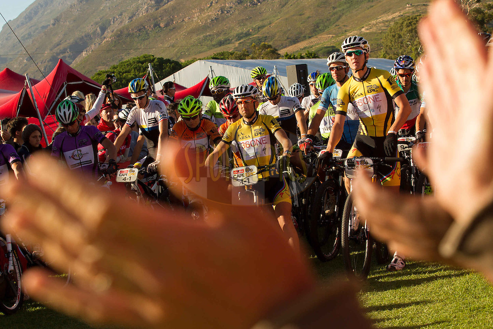 Crowds cheer on the lead riders as they prepare to set off for the final stage (stage 7) of the 2013 Absa Cape Epic Mountain Bike stage race from Stellenbosch to Lourensford Wine Estate in Somerset West, South Africa on the 24 March 2013..Photo by Greg Beadle/Cape Epic/SPORTZPICS